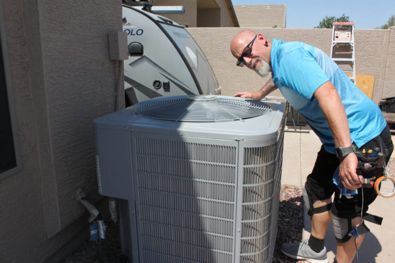 Home Inspector Daren Wright inspecting and HVAC unit